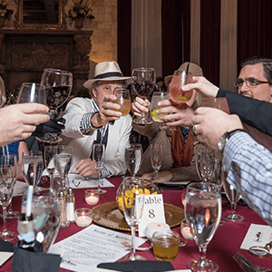 Baltimore Murder Mystery guests raise glasses