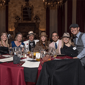 Baltimore Murder Mystery party guests at the table